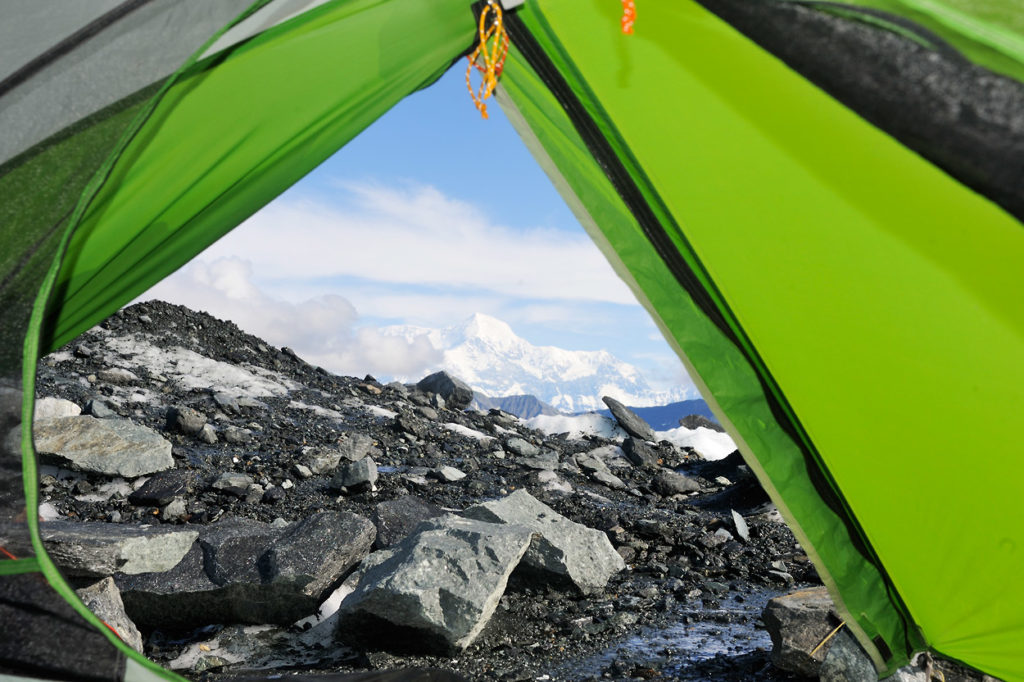 View out the door of backpacking tent on Malaspina Glacier backpacking trip in Wrangell - St. Elias National Park, Alaska.