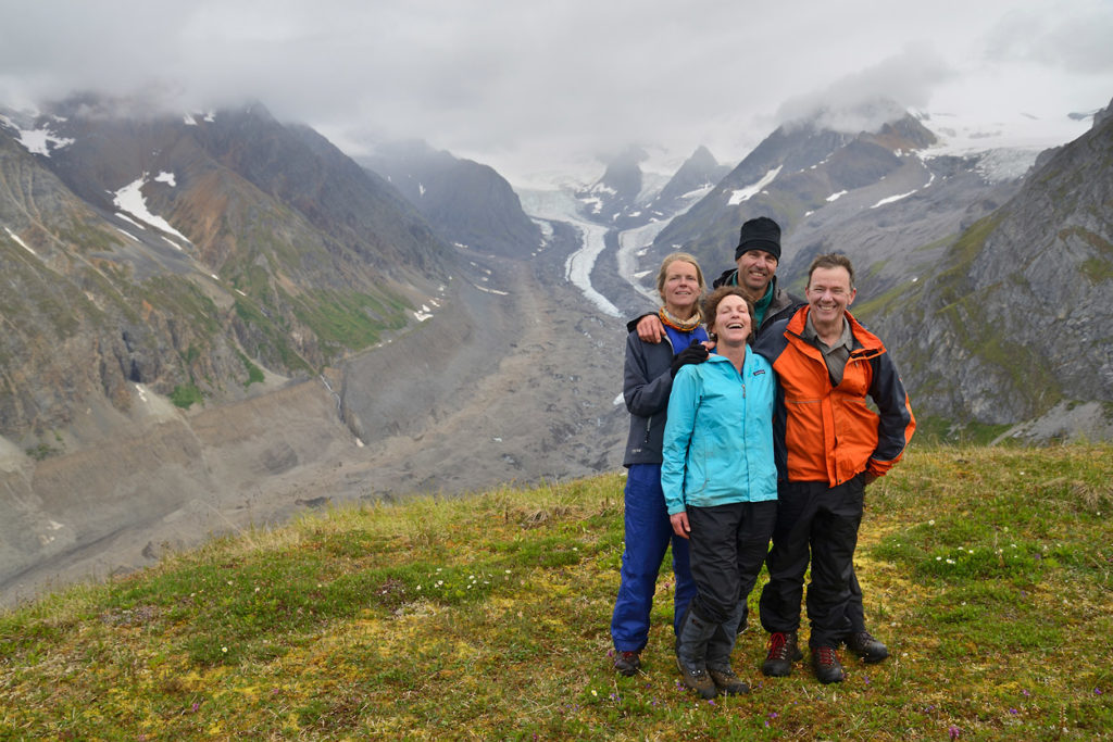 A group of hikers above Lakina River, Wrangell - St. Elias National Park, Alaska.
