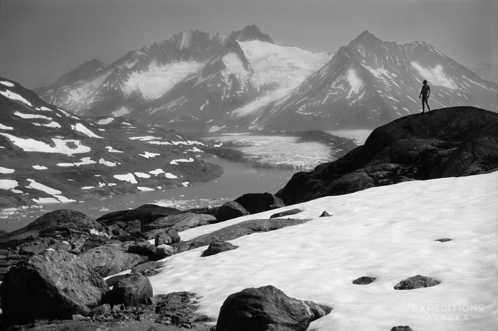 Hiker alone in Chugach Mountains of Wrangell - St. Elias National Park and Preserve, Alaska