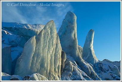 Ice pillars on Kennicott Glacier glow in the late afternoon sun, Wrangell - St. Elias National Park, Alaska.