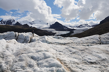 Hiker on Russell Glacier, Wrangell - St. Elias National Park and Preserve, Alaska.