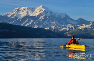 Sea kayaking in Icy Bay, with Mount St. Elias rising in the background, 18 008' high above the sea. Wrangell - St. Elias National Park and Preserve, Alaska.