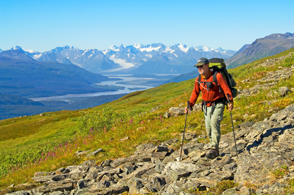 Backpacker hiking Southern Traverse backpacking trip Bremner River, Wrangell - St. Elias National Park, Alaska.