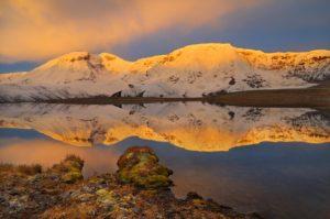 Alaska hiking tours Mt Jarvis at sunrise, from the Jarvis plateau, Wrangell - St. Elias National Park, Alaska.